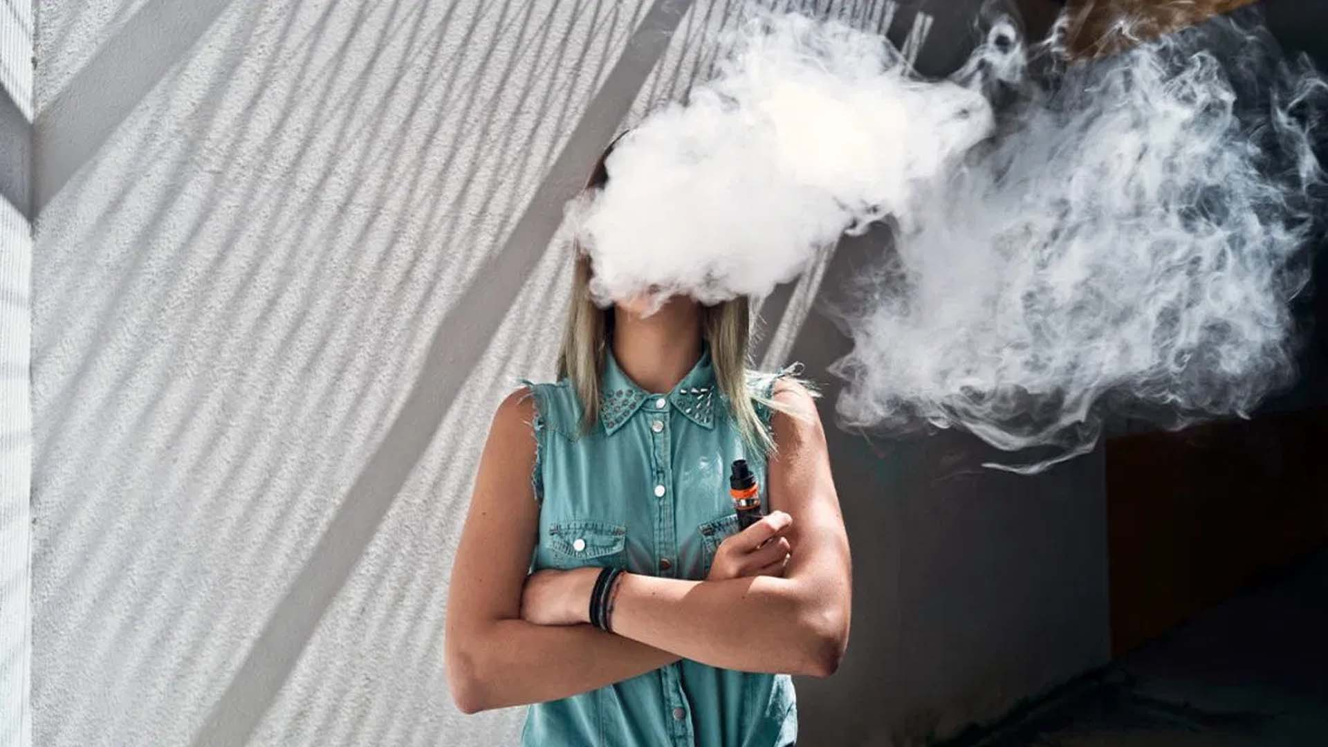Image of a woman vaping outside